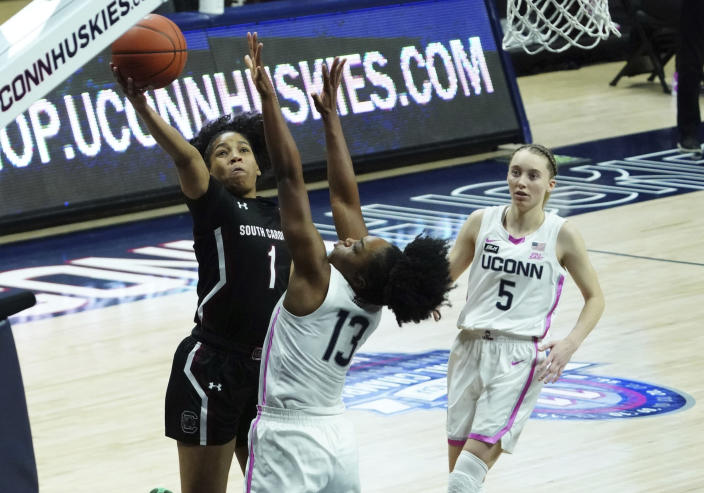 South Carolina guard Zia Cooke (1) shoots against Connecticut guard Christyn Williams (13) in the second half of an NCAA college basketball game in Storrs, Conn., Monday, Feb. 8, 2021. (David Butler/Pool Photo via AP)