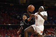 Maryland guard Ashley Owusu (15) goes to the basket next to Wagner guard Alex Cowan (0) during the second half of an NCAA college basketball game, Tuesday, Nov. 5, 2019, in College Park, Md. Maryland won 119-56. (AP Photo/Nick Wass)