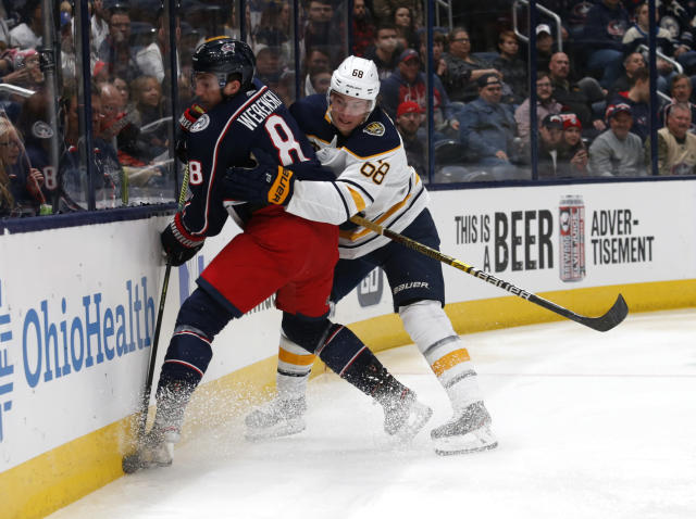 Buffalo Sabres forward Victor Olofsson, right, of Sweden, works against Columbus Blue Jackets defenseman Zach Werenski during the first period of an NHL hockey game in Columbus, Ohio, Monday, Oct. 7, 2019. (AP Photo/Paul Vernon)