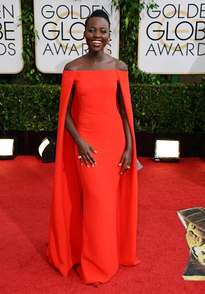 "FILE - In this Jan. 12, 2014 file photo, Lupita Nyong'o arrives in a stunning Ralph Lauren Collection red caped gown at the 71st annual Golden Globe Awards at the Beverly Hilton Hotel, in Beverly Hills, Calif. Nyong'o is nominated for an Oscar for performance by an actress in a supporting role for the film, ""12 Years a Slave."" The 86th annual Academy Awards will be presented on Sunday, March 2, 2014. (Photo by Jordan Strauss/Invision/AP, file)"