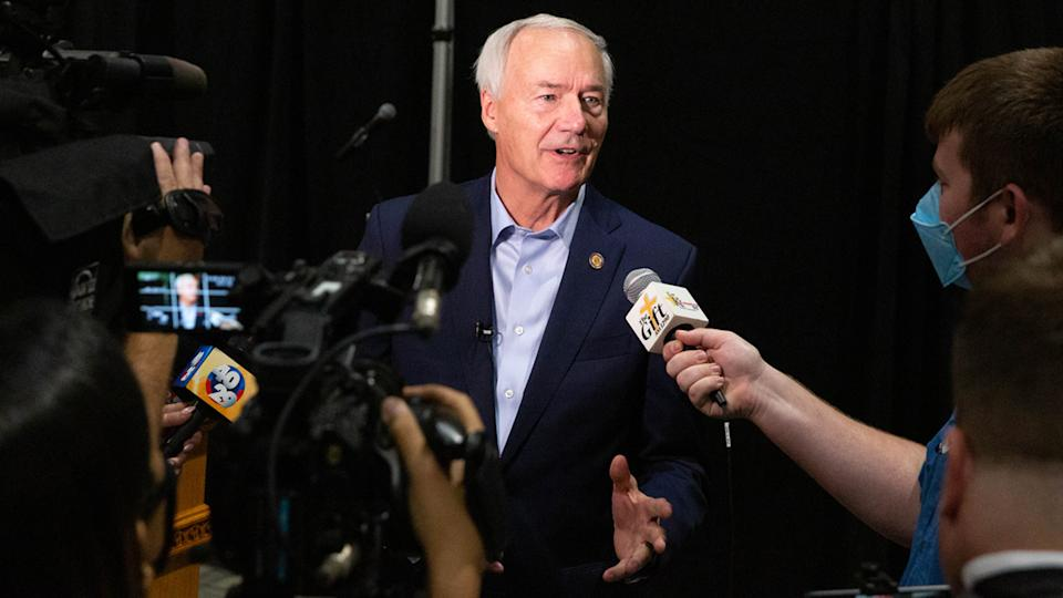 Asa Hutchinson, governor of Arkansas, speaks with members of the media following a community town hall to promote Covid-19 vaccinations at Arkansas State UniversityMountain Home (ASUMH) in Mountain Home, Arkansas, U.S., on Monday, July 16, 2021. (Liz Sanders/Bloomberg via Getty Images)