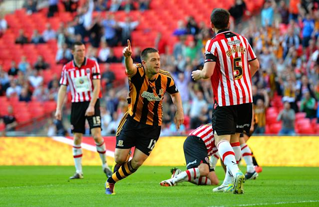 LONDON, ENGLAND - APRIL 13: Matthew Fryatt of Hull City turns to the celebrate after scoring their second goal during the FA Cup with Budweiser semi-final match between Hull City and Sheffield United at Wembley Stadium on April 13, 2014 in London, England. (Photo by Shaun Botterill/Getty Images)