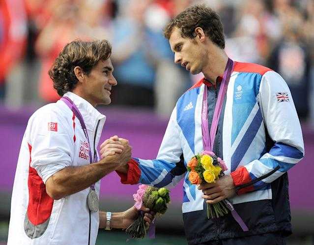 Roger Federer shakes hands with Andy Murray at the London 2012 Olympics (EPA)