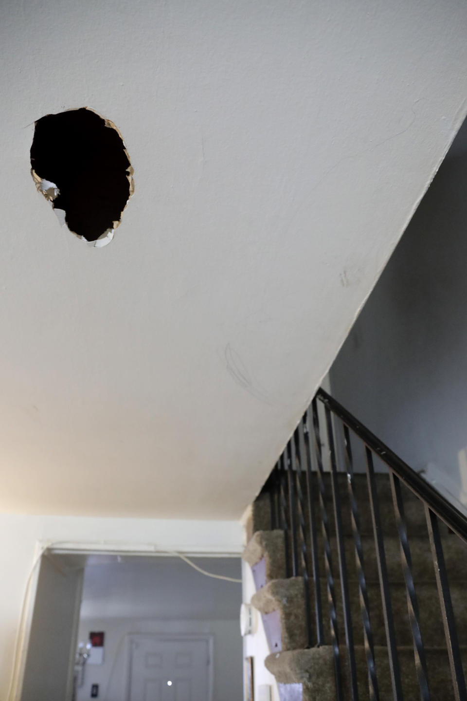 A hole is seen on the ceiling of the first floor of Carrie Newson's residence at the Dutch Village apartments, Tuesday, July 30, 2019, in Baltimore. Newson has complained to management about mice and mold in her home but the issues have yet to be fixed. The apartment complex is owned by Jared Kushner, son-in-law of President Donald Trump. (AP Photo/Julio Cortez)