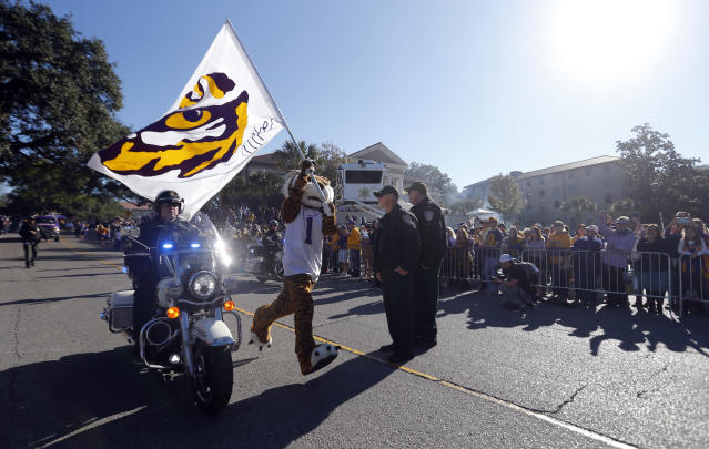 The LSU mascot Mike the Tiger runs down the road outside Tiger Stadium before an NCAA college football game against Arkansas in Baton Rouge, La., Saturday, Nov. 11, 2017. (AP Photo/Gerald Herbert)