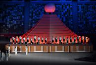 <p>Performers attend the opening ceremony of the Tokyo 2020 Olympic Games, at the Olympic Stadium in Tokyo, on July 23, 2021. (Photo by Dylan MARTINEZ / various sources / AFP) (Photo by DYLAN MARTINEZ/AFP via Getty Images)</p>