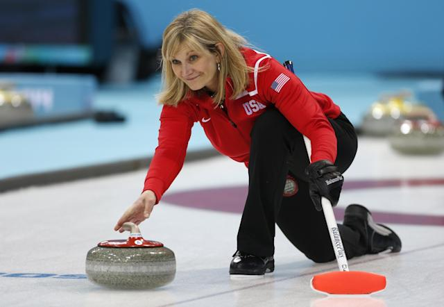 Erika Brown, skip of Team USA, delivers the stone during a women's curling training session at the 2014 Winter Olympics, Sunday, Feb. 9, 2014, in Sochi, Russia. (AP Photo/Robert F. Bukaty)