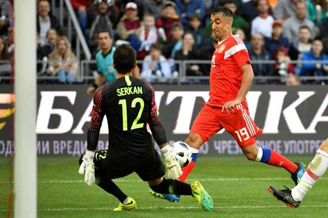 Russia's Alexander Samedov shoots to score the opening goal during an international friendly against Turkey