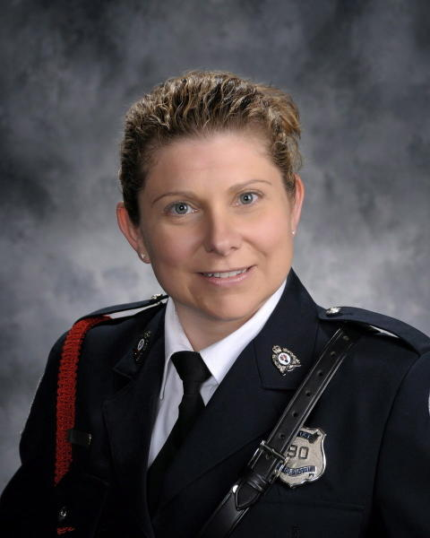 This undated photo provided by Fredericton Police Force shows Sara Burns. A shooting in a small Canadian city Friday, Aug. 10, 2018, that left several people dead, including Burns and another police officer who were responding to call of shots fired, struck a nerve in a country that has been roiled in recent months by several instances of mass violence. (Fredericton Police Force via AP)