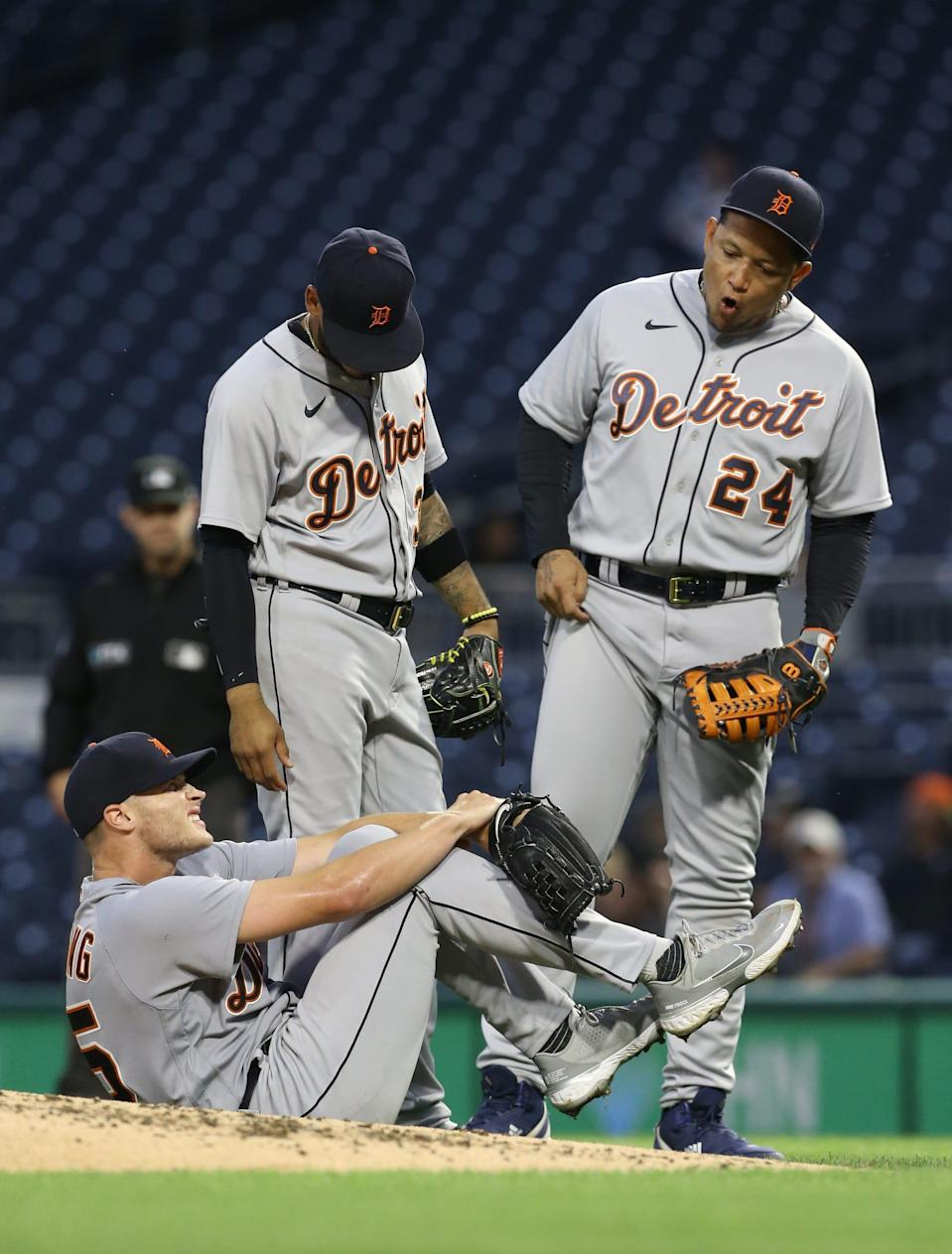 Detroit Tigers starting pitcher Matt Manning (25) reacts after being struck by a line drive hit by Pittsburgh Pirates first baseman Colin Moran (not pictured) as shortstop Harold Castro (30) and first baseman Miguel Cabrera (24) look on during the third inning at PNC Park in Pittsburgh on Wednesday, Sept. 8, 2021.