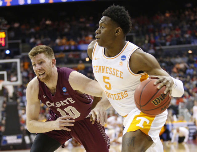 Tennessee's Admiral Schofield (5) drives past Colgate's Will Rayman (10) in the first half of a first-round game in the NCAA mens college basketball tournament in Columbus, Ohio, Friday, March 22, 2019. (AP Photo/Paul Vernon)