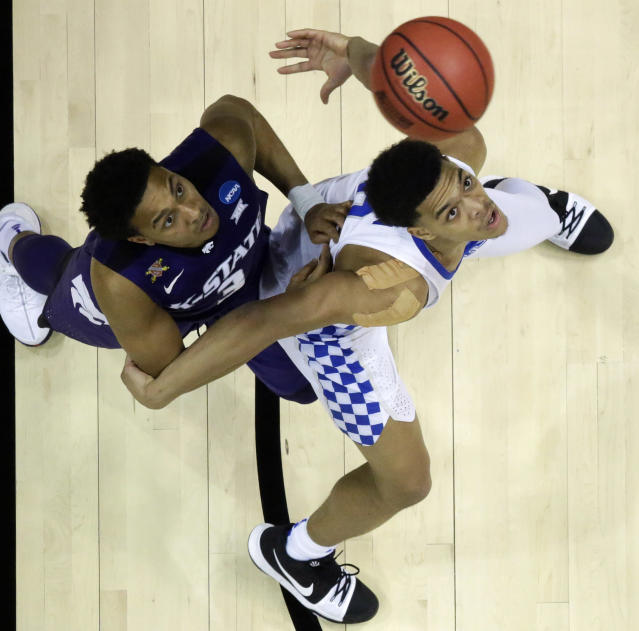 Kansas State guard Kamau Stokes (3) and Kentucky forward Kevin Knox (5) wait for a ball during the second half of a regional semifinal NCAA college basketball tournament game, Friday, March 23, 2018, in Atlanta. Kansas State won 61-58. (AP Photo/David Goldman)