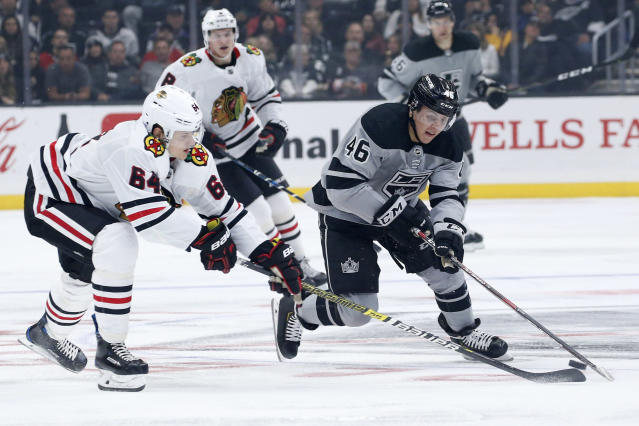 Los Angeles Kings forward Blake Lizotte (46) vies with Chicago Blackhawks forward David Kampf (64) for the puck during the second period of an NHL hockey game Saturday, Nov. 2, 2019, in Los Angeles. (AP Photo/Ringo H.W. Chiu)