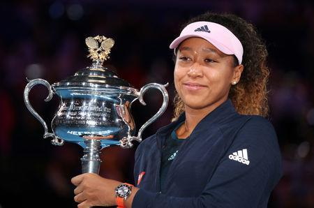 Tennis - Australian Open - Women's Singles Final - Melbourne Park, Melbourne, Australia, January 26, 2019. Japan's Naomi Osaka poses with the trophy after winning her match against Czech Republic's Petra Kvitova. REUTERS/Lucy Nicholson