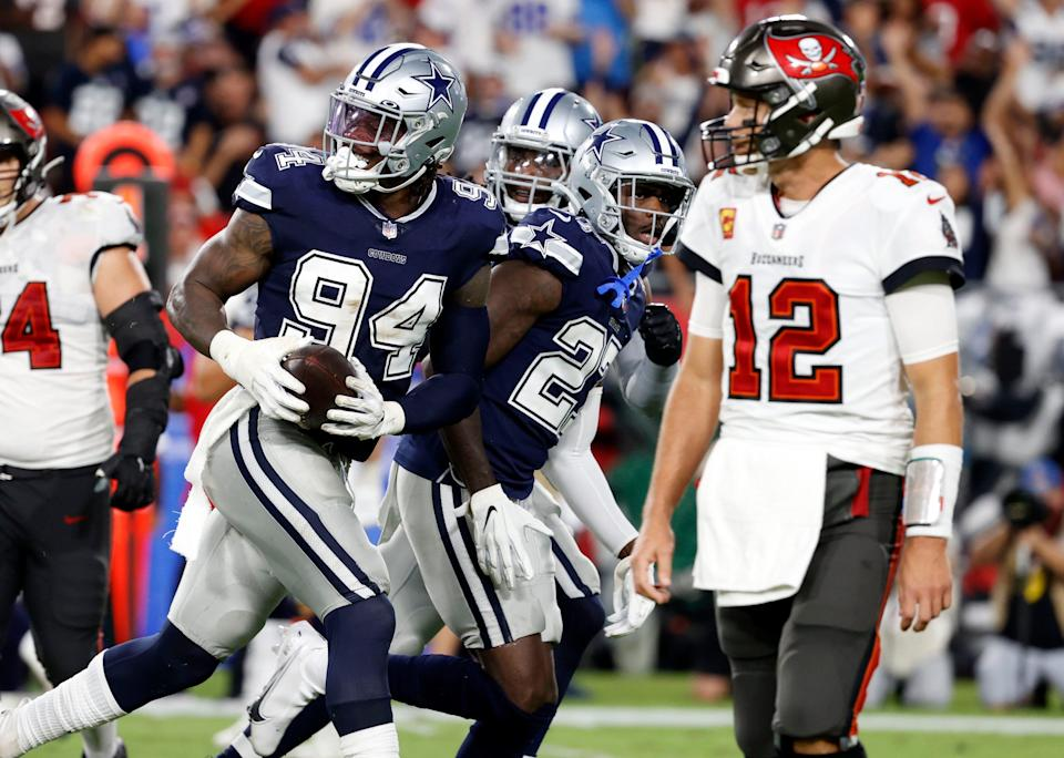 Cowboys defensive end Randy Gregory (94) reacts after recovering the ball against the Buccaneers on Thursday.