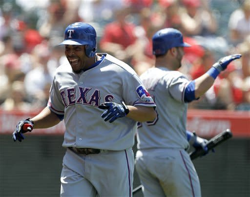 Texas Rangers' Nelson Cruz celebrates his two-run home run against the Los Angeles Angels during the seventh inning of a baseball game in Anaheim, Calif., Sunday, June 3, 2012. (AP Photo/Chris Carlson)