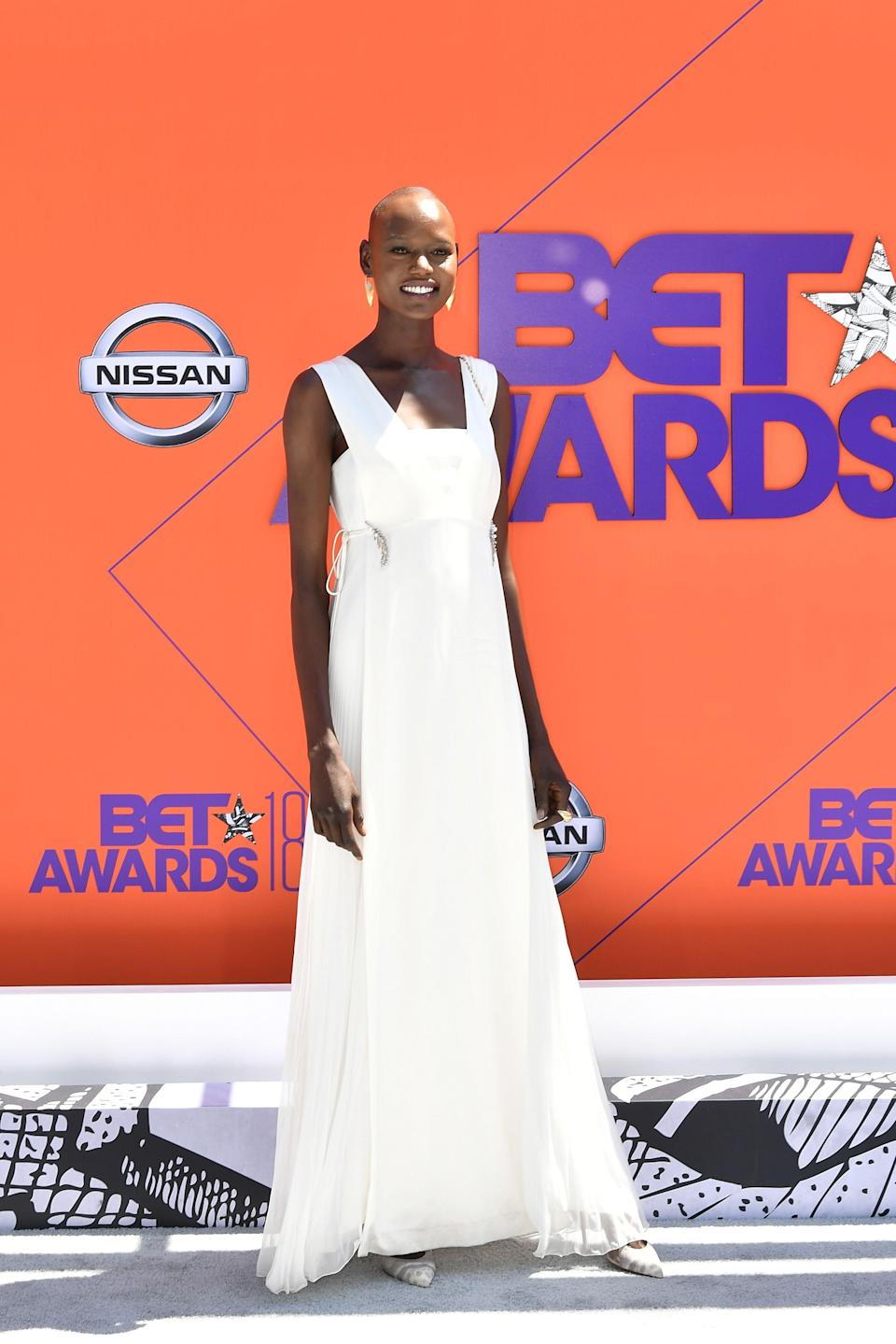 "<p>Model, Ajak Deng is showing us what glamour looks like in this white gown.</p><span class=""copyright"">Photo: Earl Gibson III/Getty Images.</span>"