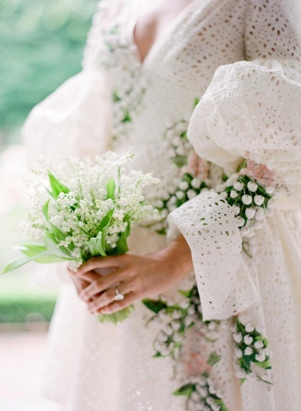 The bouquet! Inspired by the embroidered lily of the valley, Putnam & Putnam created the most beautiful bouquet wrapped in pale pink ribbon to match my dress.