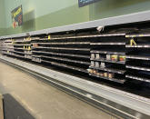 This photo provided by Rodney Giles shows empty shelves at an H-E-B grocery store on Tuesday, Feb. 17, 2021 at an H-E-B grocery store near Woodlands, Texas. A series of winter storms and widespread power outages gripping Texas and other states not used to such extreme low temperatures are creating big challenges in the nation's food supply networks. (Rodney Giles via AP)
