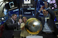 Toast co-Founder Jonathan Grimm, left, rings the ceremonial first-trade bell, joined by SVP for Finance Jennifer DiRico and fellow co-Founder Steve Fredette, as their IPO begins trading, on the floor of the New York Stock Exchange, Wednesday, Sept. 22, 2021. (AP Photo/Richard Drew)