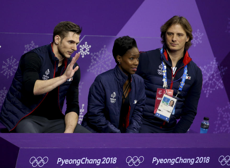 Vanessa James and Morgan Cipres of France with their coach John Zimmerman at the 2018 Olympics