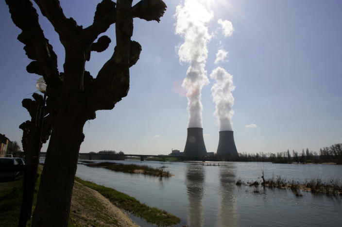 FILE - This March 27, 2007 file photo shows the Belleville-sur-Loire's nuclear plant, across the Loire river, central France. France's nuclear safety authority gave its green light on Thursday to extend the lifetime of the country's 32 oldest nuclear reactors for an additional decade, potentially allowing them to be operational for as long as 50 years. (AP Photo/Francois Mori, File)