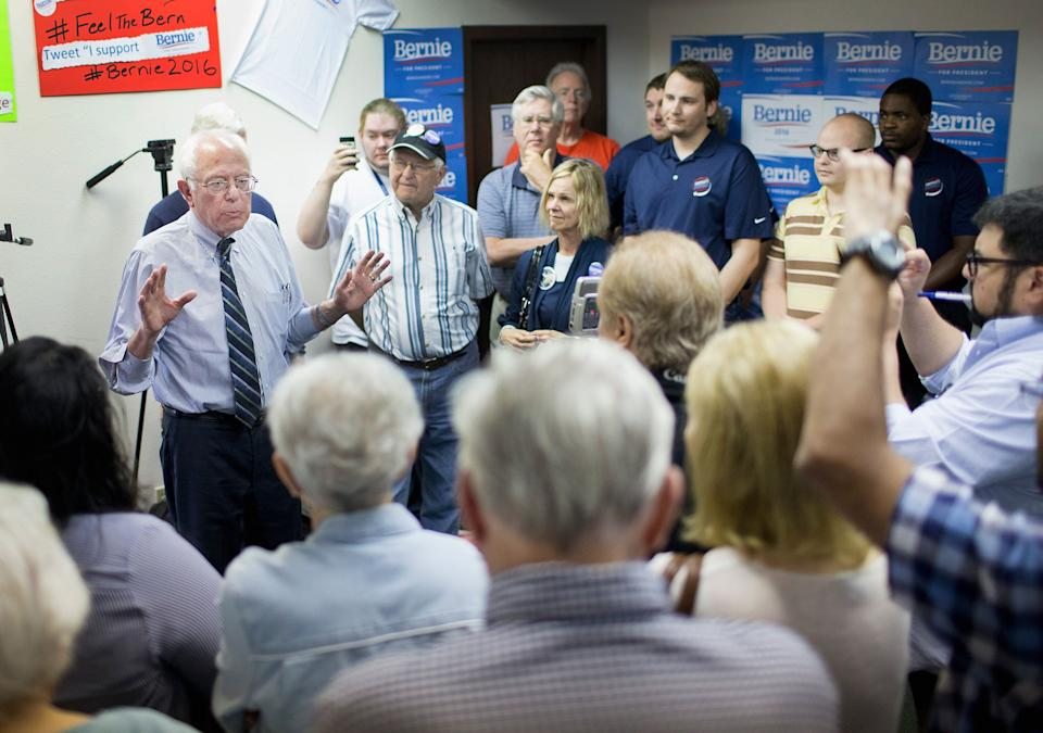 Sen. Bernie Sanders chats with supporters during a visit to his Iowa campaign headquarters on June 13, 2015 in Des Moines, Iowa.