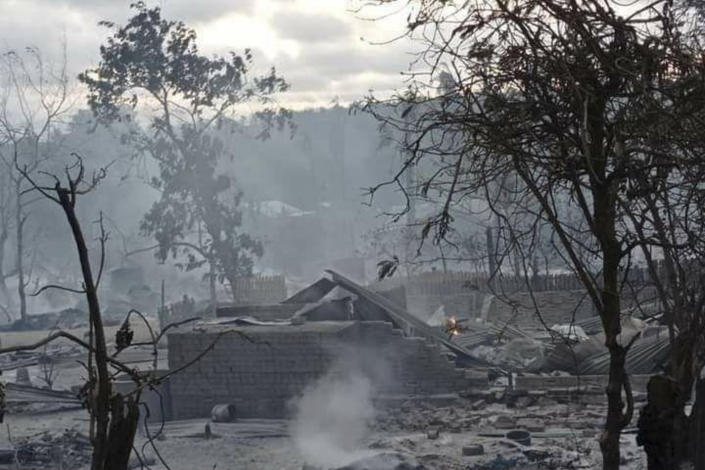 Smoke rises from smoldering houses in Kinma village, Pauk township, Magwe division, central Myanmar, Wednesday June 16, 2021. Residents said people are missing after military troops burned the village the night before. (AP Photo)