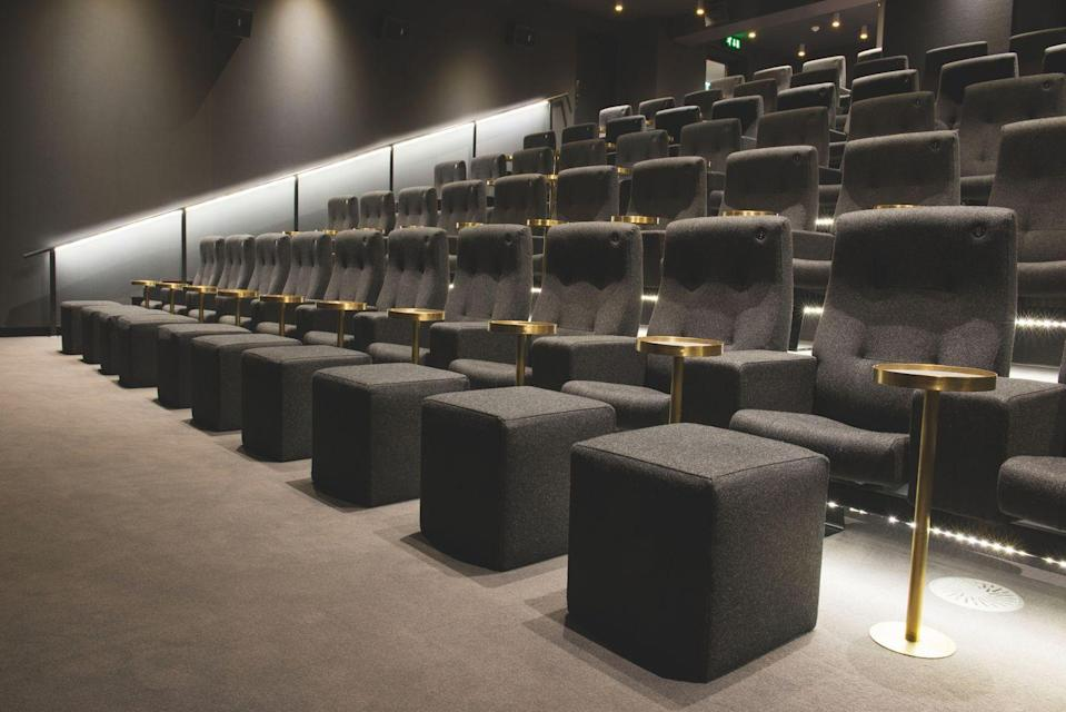 """<p>The cinema inside the Olympic Recording Studios will lure you in with their opulent brass side tables, carpeted floor and popcorn served in minimalistic paper bags. If you're as obsessed with <a href=""""https://www.elledecor.com/design-decorate/trends/g2475/scandinavian-trends/"""" rel=""""nofollow noopener"""" target=""""_blank"""" data-ylk=""""slk:Scandinavian"""" class=""""link rapid-noclick-resp"""">Scandinavian </a>designs as Instagram is, you will love their Norwegian armchairs. The front row is equipped with spacious footstools to enhance the luxurious cinematic experience and for the snugglers out there; head to the back for two-person love seats and sofas.</p><p>Address: 117-123 Church Rd, Barnes, London SW13 9HL</p><p>Click <a href=""""https://www.olympiccinema.co.uk"""" rel=""""nofollow noopener"""" target=""""_blank"""" data-ylk=""""slk:here"""" class=""""link rapid-noclick-resp"""">here</a> for more information.<br></p>"""