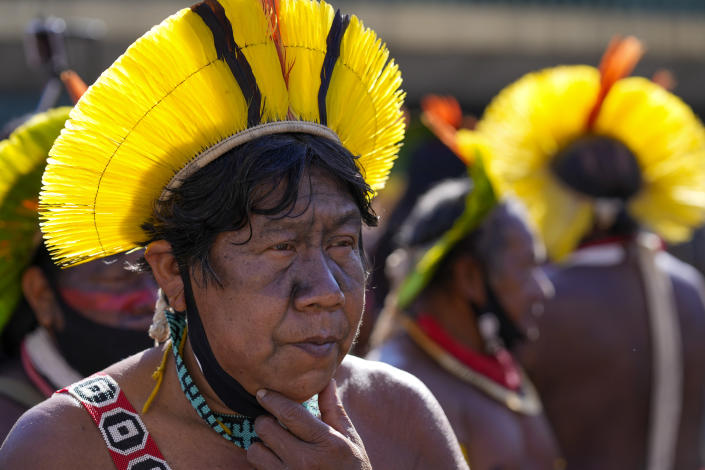 An Indigenous leader protests outside Congress in Brasilia, Brazil, Wednesday, June 23, 2021. Indigenous activists have traveled to the capital to demand government action to halt illegal mining and logging on their reservations and oppose a proposed bill they say would limit recognition of tribal lands. (AP Photo/Ricardo Mazalan)