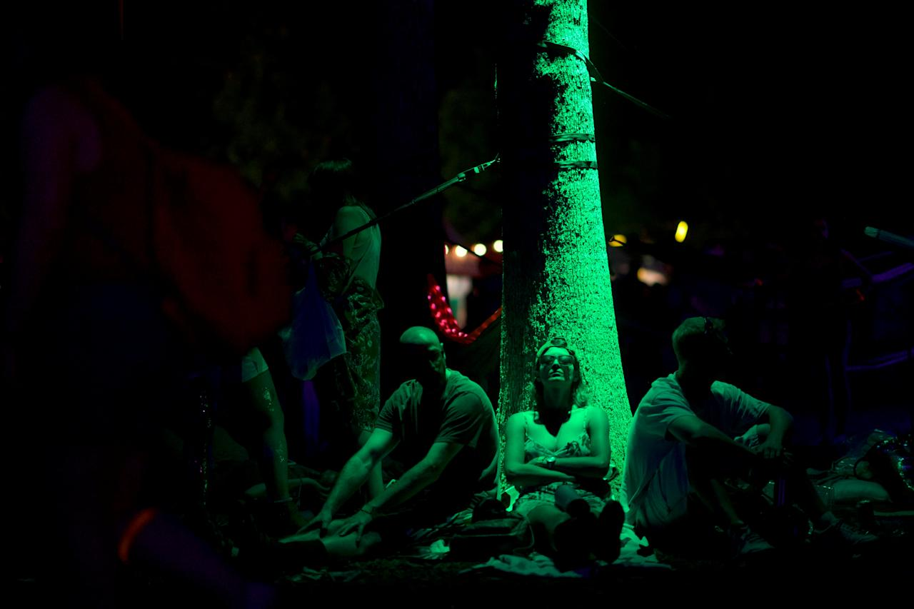 Concert goers rest against a tree after The Killers performed on the third day of the Firefly Music Festival in Dover, Delaware U.S., June 16, 2018.  REUTERS/Mark Makela