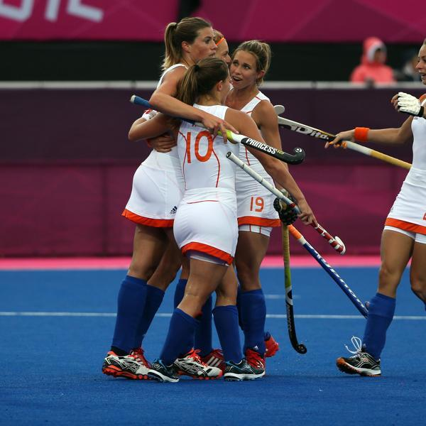 LONDON, ENGLAND - JULY 31: Kim Lammers (L) of the Netherlands is congratulated by team-mates after scoring a goal during the Women's Hockey Match between the Netherlands and Japan on day 4 of the London 2012 Olympic Games at Hockey Centre on July 31, 2012 in London, England. (Photo by Daniel Berehulak/Getty Images)