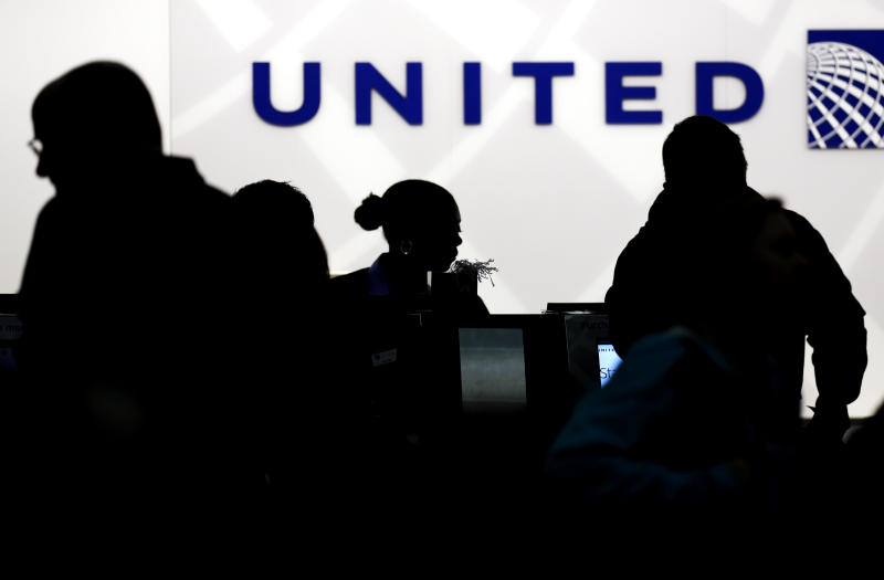 Holiday travelers check in at the United Airlines ticket counter at Terminal 1 in O'Hare International Airport in Chicago on Saturday, Dec. 21, 2013. The National Weather Service issued a hazardous weather outlook for north central Illinois, northeast Illinois and northwest Indiana on Saturday morning. (AP Photo/Nam Y. Huh)