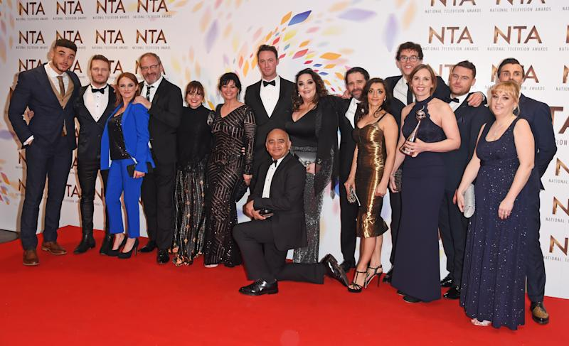 "LONDON, ENGLAND - JANUARY 28: Cast members including Jurell Carter, Matthew Wolfenden, Natalie J. Robb, Jonny McPherson, Bhasker Patel, Lisa Riley, Rebecca Sarker, Mark Charnock, Danny Miller and Jonathan Wrather, accepting the Serial Drama award for ""Emmerdale"", pose in the winners room at the National Television Awards 2020 at The O2 Arena on January 28, 2020 in London, England. (Photo by David M. Benett/Dave Benett/Getty Images)"