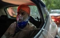 A man with a breathing problem receives oxygen support for free at a Gurudwara, in Ghaziabad