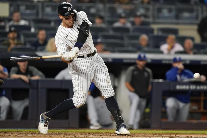 New York Yankees' Aaron Judge hits an RBI-single during the third inning of a baseball game against the Texas Rangers, Monday, Sept. 20, 2021, in New York. (AP Photo/Frank Franklin II)