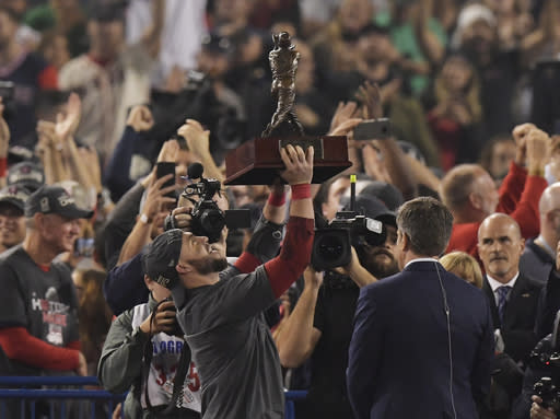 Boston Red Sox's Steve Pearce holds the MVP trophy after Game 5 of baseball's World Series against the Los Angeles Dodgers on Sunday, Oct. 28, 2018, in Los Angeles. The Red Sox won 5-1 to win the series 4 game to 1. (AP Photo/Mark J. Terrill)