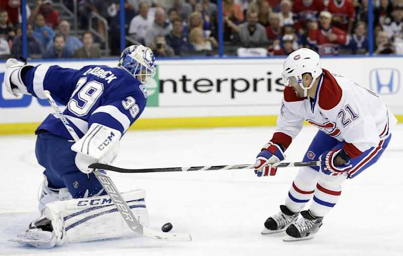 Tampa Bay Lightning goalie Anders Lindback (39), of Sweden, stops a breakaway by Montreal Canadiens right wing Brian Gionta (21) during the first period of Game 2 of a first-round NHL hockey playoff series on Friday, April 18, 2014, in Tampa, Fla. (AP Photo/Chris O'Meara)