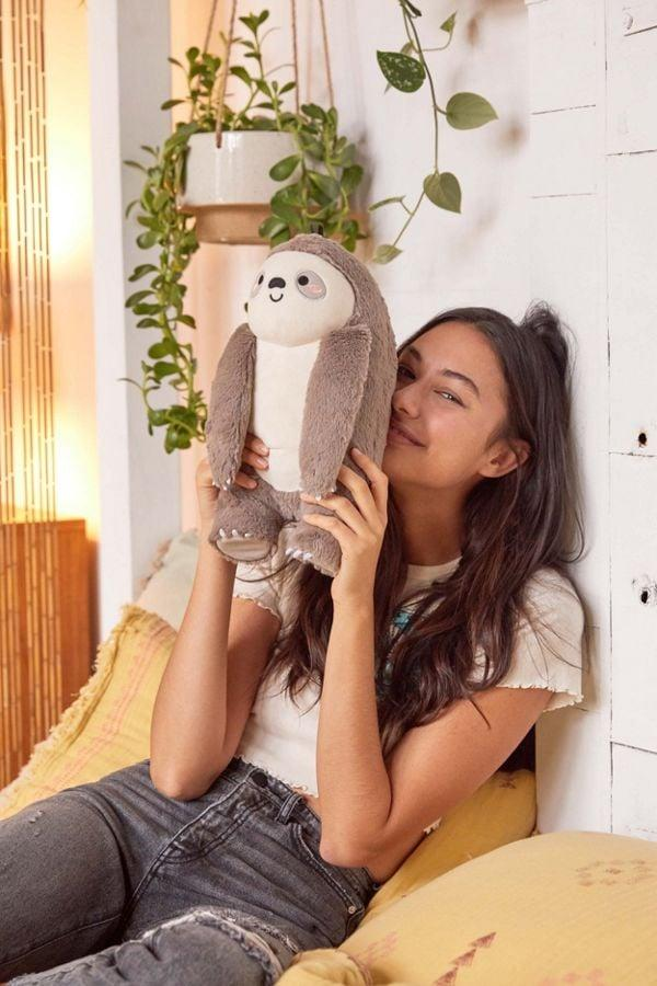 """<p><a href=""""https://www.popsugar.com/buy/Smoko-Toasty-Heatable-Sloth-Plushie-484346?p_name=Smoko%20Toasty%20Heatable%20Sloth%20Plushie&retailer=urbanoutfitters.com&pid=484346&price=29&evar1=savvy%3Aus&evar9=46546421&evar98=https%3A%2F%2Fwww.popsugar.com%2Fsmart-living%2Fphoto-gallery%2F46546421%2Fimage%2F46546817%2FSmoko-Toasty-Heatable-Plushie&list1=pillows%2Curban%20outfitters%2Csloth&prop13=mobile&pdata=1"""" rel=""""nofollow"""" data-shoppable-link=""""1"""" target=""""_blank"""" class=""""ga-track"""" data-ga-category=""""Related"""" data-ga-label=""""http://www.urbanoutfitters.com/shop/smoko-toasty-heatable-plushie?category=party-supplies-games&amp;color=004&amp;quantity=1&amp;size=ONE%20SIZE&amp;type=REGULAR&amp;viewcode=b"""" data-ga-action=""""In-Line Links"""">Smoko Toasty Heatable Sloth Plushie</a> ($29)</p>"""