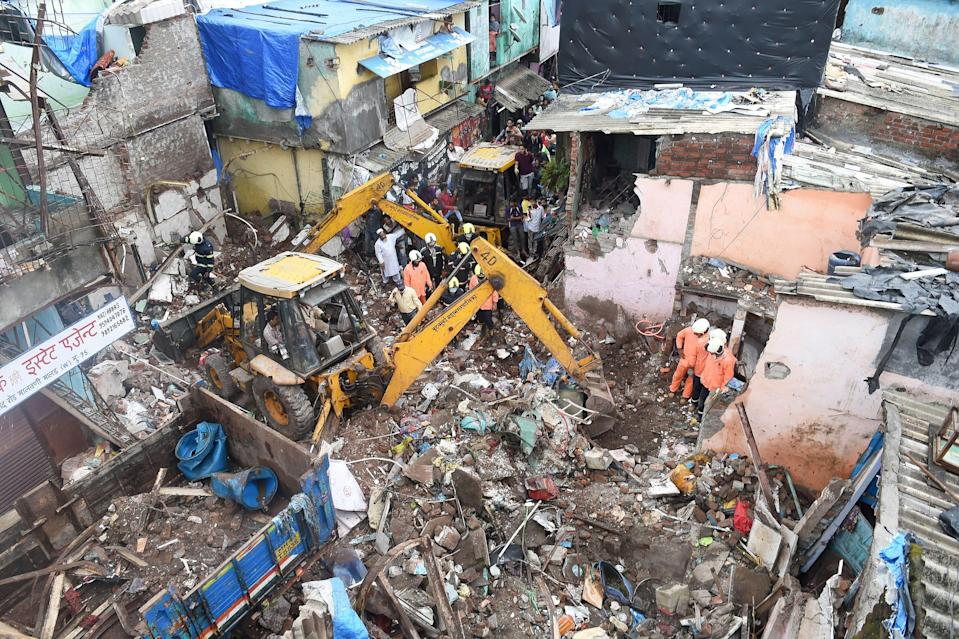 Rescue operation underway after a building collapsed on another structure in Malwani area on Wednesday night, in Mumbai. At least eight children and three adults died and seven other people were injured.