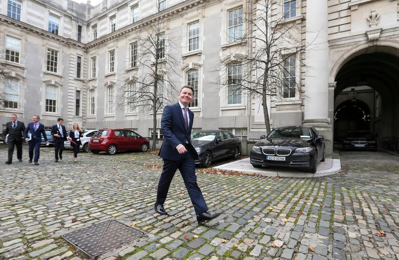 FILE PHOTO: FILE PHOTO: Irish Finance Minister Paschal Donohoe walks outside Government Buildings in Dublin