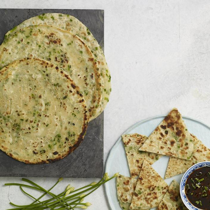 <p>In this traditional Chinese pancake recipe, chives are added for a pretty green hue and savory flavor. Serve as an appetizer with a soy dipping sauce or use like a tortilla for chicken or pork that's been marinated in ginger and soy sauce. The amount of water needed for the dough will vary depending on the type of flour and the humidity.</p>