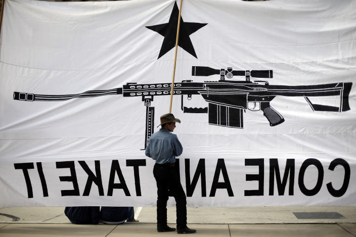 Austin Ehlinger helps hold a banner during a Guns Across America rally at the state capitol, Saturday, Jan. 19, 2013, in Austin, Texas. Texas officials opposed to new federal gun control proposals plan to speak on the steps of the state Capitol during a pro-Second Amendment rally. The event is one of many rallies planned across the country Saturday. They come four days after President Barack Obama unveiled a sweeping plan to curb gun violence. (AP Photo/Eric Gay)