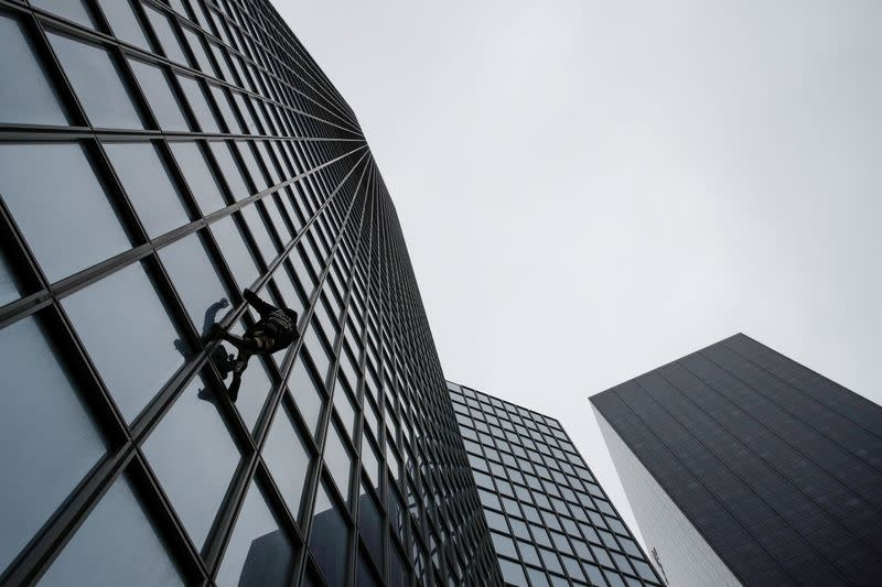 'French Spider-Man' scales Total tower in support of pension strikes