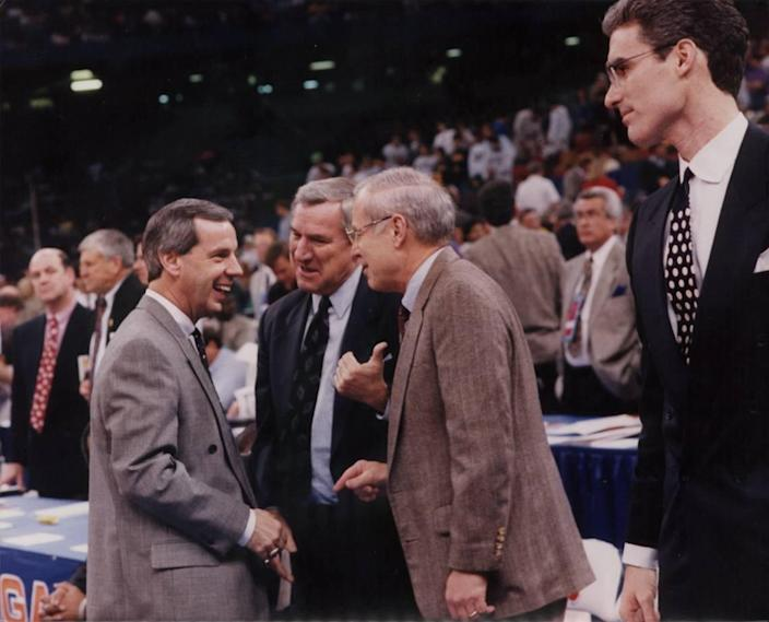 From left to right: Roy Williams, Dean Smith, Bill Guthridge and Matt Doherty. The four coaches chatted with each other just before UNC beat Kansas in the 1993 Final Four basketball tournament in New Orleans. Williams was the head coach at Kansas at the time and Doherty was his assistant. Smith was UNC's head coach and Guthridge was his assistant. All four men would eventually serve as the head coach at UNC.