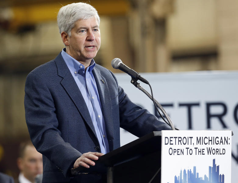 Michigan Gov. Rick Snyder speaks at the IDEAL Group Thursday, Jan. 23, 2014 in Detroit. Snyder announced a plan to ask the Obama administration to set aside thousands of work visas to entice talented immigrants to live and work in bankrupt Detroit. The Republican governor said he is seeking 50,000 work visas solely for the city over five years. (AP Photo/Paul Sancya)