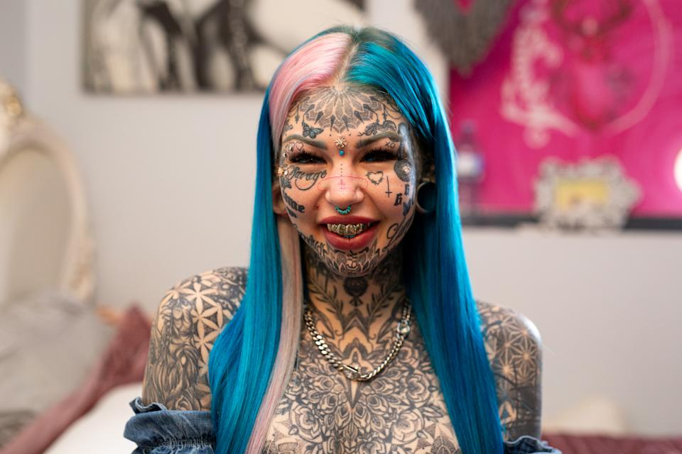"BRISBANE, AUSTRALIA - MAY 28, 2020: AMBER LUKE, 25, from Brisbane, Australia has 600 tattoos covering her face and body. She first filmed with Truly last year, revealing her blue tattooed eyes which blinded her for three weeks. Since then, she has continued to add to her collection with stretched ear lobes, more tattoos, and plans to get a Brazilian Butt Lift. Her journey into body modification began when she was diagnosed with severe clinical depression at 16-years-old. She explained the reasons behind her extreme look to Truly: ""I know it sounds very materialistic that I want to change myself but imagine hating yourself so much that you couldn't even look in a mirror or step outside your house. It was just, it was a horrific way to live."" Amber has now spent $50,000 on tattoos, and $70,000 overall on body modifications. She joked that the high cost makes her mum cry, but Amber doesn't ""plan on stopping anytime soon"". Her next procedure will be a Brazilian Butt Lift, which she has gained 10 kilos for, as the fat will be injected into her butt. She said: ""A lot of people will give me scrutiny for this because, you know, 'Why not just go to the gym'?"" Amber continued: ""I'm lazy, I'd rather pay the 15 grand."" Now she feels much more content and has been with her partner Sam for six months. ""He is absolutely amazing,"" she said. ""There's not anything that I do or say that scares him away."" PHOTOGRAPH BY Joshua Maguire / Barcroft Studios / Future Publishing - NOTE: This Photo Can Only Be Used Within Context With The Information Provided In The Metadata (Photo credit should read Joshua Maguire/Barcroft Media via Getty Images)"