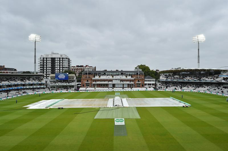 The covers protect the pitch from the rain during a delay in play on the third day of the second Ashes cricket Test match between England and Australia at Lord's Cricket Ground in London on August 16, 2019. (Photo by Glyn KIRK / AFP) / RESTRICTED TO EDITORIAL USE. NO ASSOCIATION WITH DIRECT COMPETITOR OF SPONSOR, PARTNER, OR SUPPLIER OF THE ECB (Photo credit should read GLYN KIRK/AFP/Getty Images)