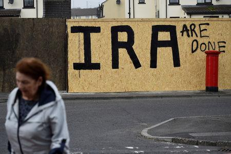 FILE PHOTO: IRA graffiti painted over with a message declaring it a defeated army in the aftermath of the killing of 29-year-old journalist Lyra McKee is pictured in Londonderry, Northern Ireland April 20, 2019. REUTERS/Clodagh Kilcoyne/File Photo