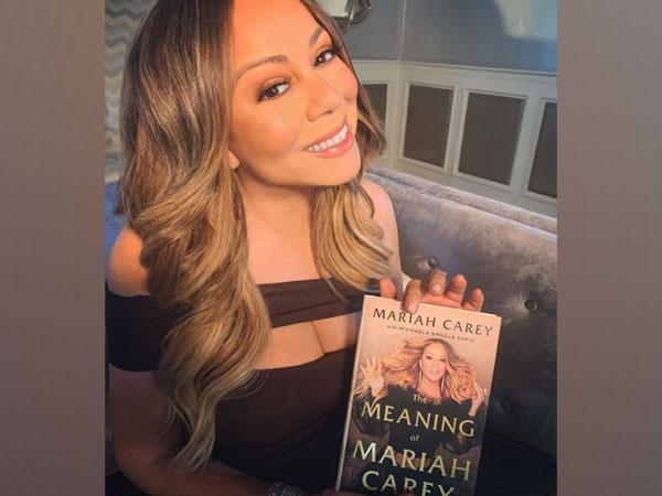 Mariah Carey with her autobiography 'The Meaning of Mariah Carey' (Image Source: Instagram)